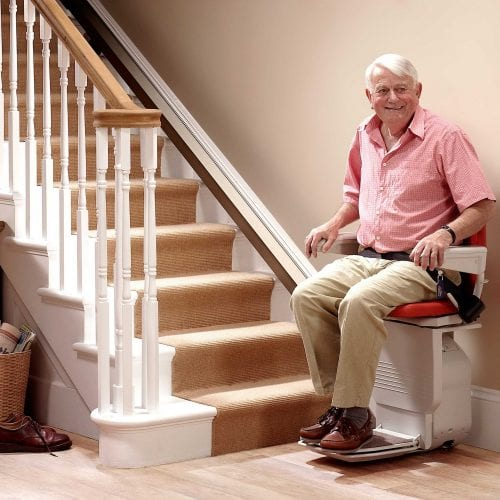 image of a stairlift with someone sitting on it